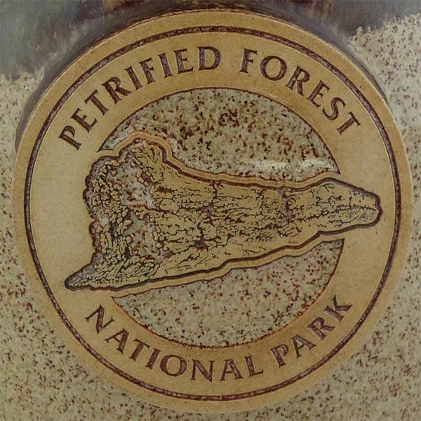 """Petrified Forest """"Old Faithful Log"""" in Cinnamon Bun color - logo"""
