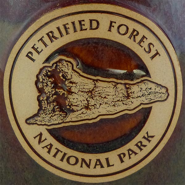 "Petrified Forest ""Old Faithful Log"" in Cranberry Bog color - logo"