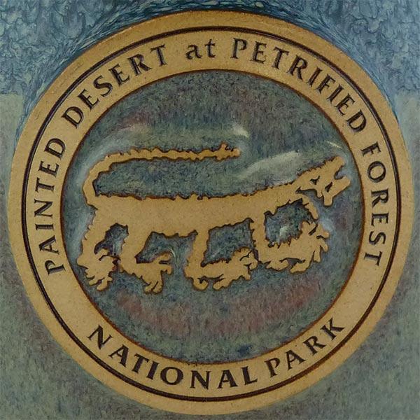 Petrified Forest Mountain Lion Petroglyph mug in Denim color - logo